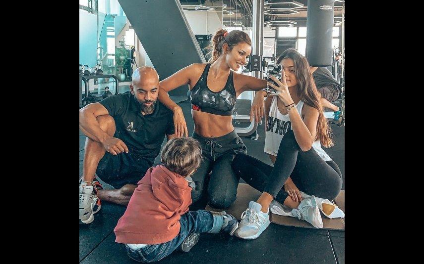 Maria Cerqueira Gomes com os filhos e Nilton Bala